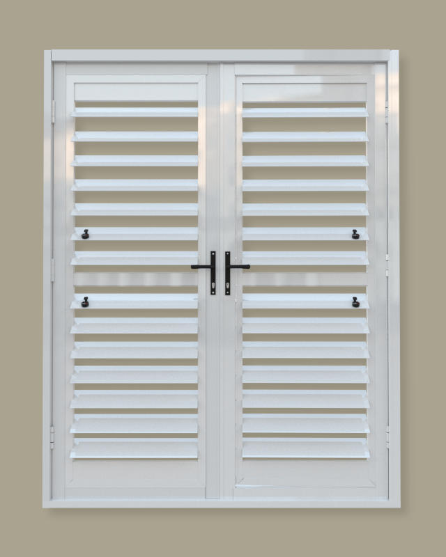 A security shutter door with centre midrail. A product of Traxdor Cape. Factory resides in Mossel Bay, Western Cape