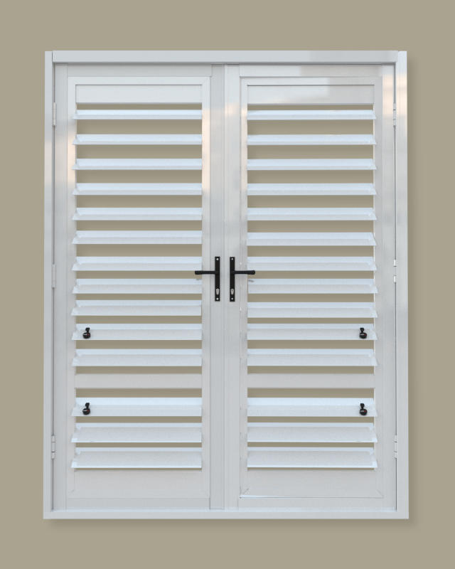 A security shutter door with off-centre midrail. A product of Traxdor Cape. Factory resides in Mossel Bay, Western Cape